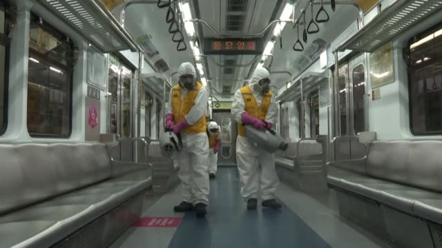 images of workers disinfecting subway trains in seoul amid the covid 19 outbreak - coreano video stock e b–roll