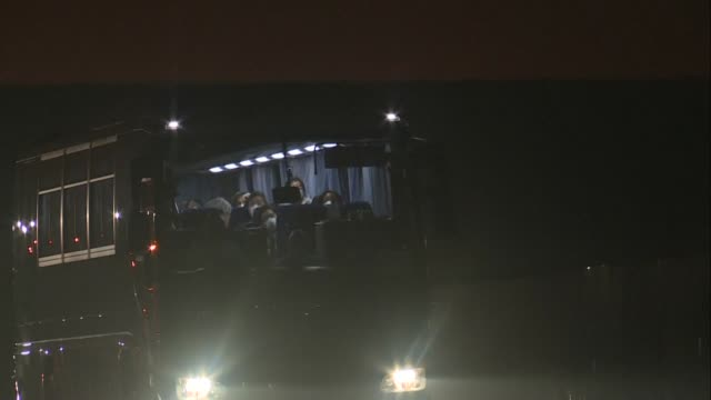 images show american tourists on buses leaving the port where their quarantined cruise ship is docked in japan to board chartered flights home as the... - cruise stock videos & royalty-free footage