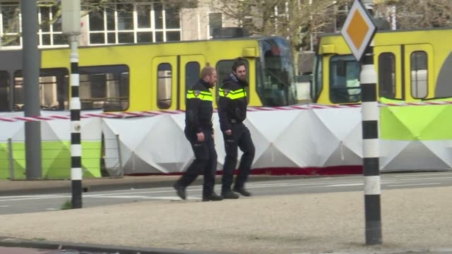 images show the tram on which a deadly gun attack occurred and police conducting house raids - utrecht stock videos & royalty-free footage