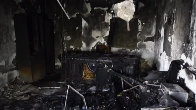 images showing the fire damage in an iraqi hezbollah office in najaf that was burnt during the overnight demonstrations against state corruption... - najaf video stock e b–roll