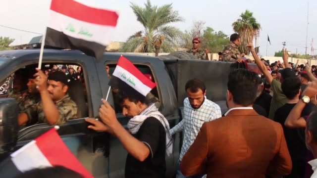 images taken on october 29 show iraqi security forces standing guard as iraqis demonstrate in the streets of the southern iraqi city of basra calling... - basra video stock e b–roll