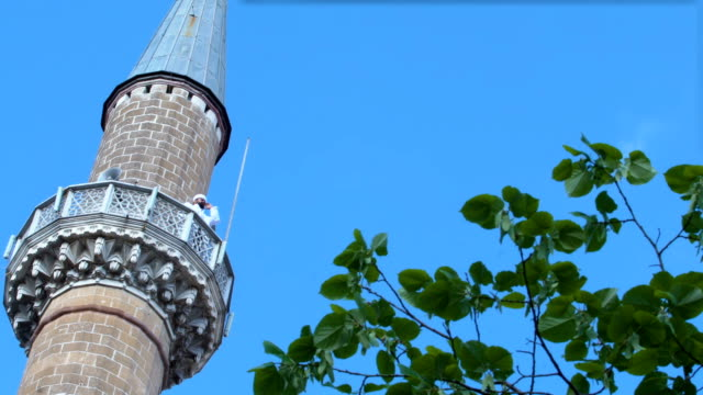 imam calling for pray on minaret - pilgrim hat stock videos & royalty-free footage