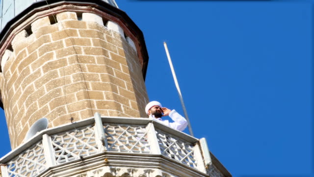 imam calling for pray on minaret - minaret stock videos & royalty-free footage