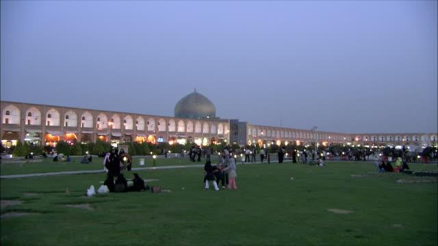 WS PAN Imam Khomeini Mosque and Sheikh Lotfollah Mosque illuminated at dusk, Naghsh-e Jahan Square, Isfahan, Iran