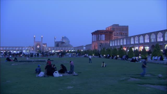 WS PAN Imam Khomeini Mosque, Sheikh Lotfollah Mosque and Ali Qapu Palace illuminated at dusk, Naghsh-e Jahan Square, Isfahan, Iran