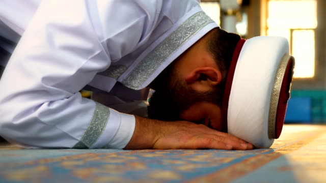 imam prays in mosque - pilgrimage stock videos & royalty-free footage