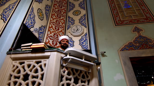 imam speaking to people in mosque - pilgrim hat stock videos & royalty-free footage