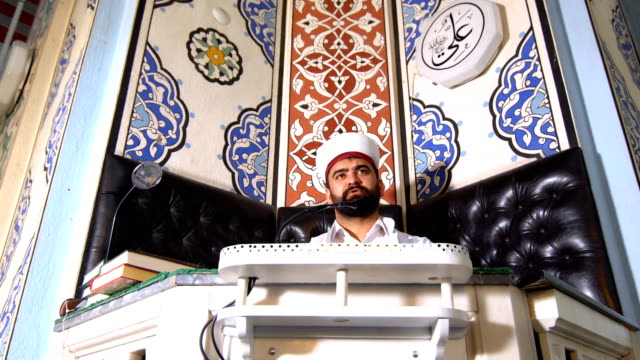 imam speaking to people in mosque - pilgrimage stock videos & royalty-free footage