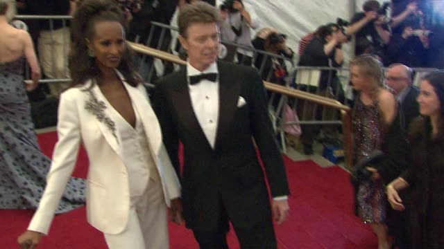Iman and David Bowie at the Metropolitan Museum of Art Costume Institute Gala 'Poiret King of Fashion' at the Metropolitan Museum of Art in New York...