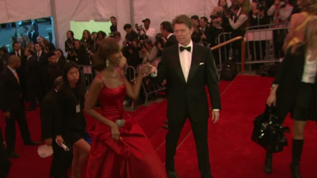 Iman and David Bowie at the Superheroes Fashion and Fantasy Costume Institute Gala at The Metropolitan Museum of Art at the Metropolitan Museum of...