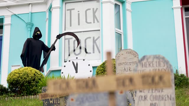 imitation grave stones symbolising the environmental emergency are seen outside a home on june 11, 2021 in falmouth, united kingdom. uk prime... - emergencies and disasters stock videos & royalty-free footage