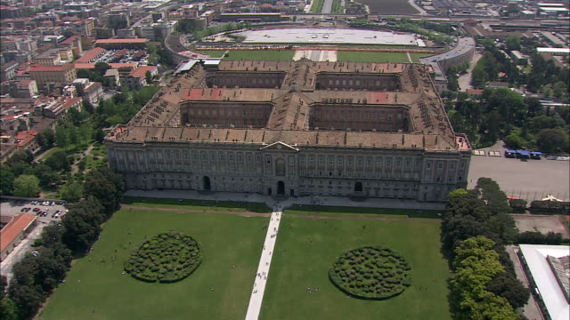 immaculate landscaping surrounds the royal palace of caserta in southern italy. - palace video stock e b–roll