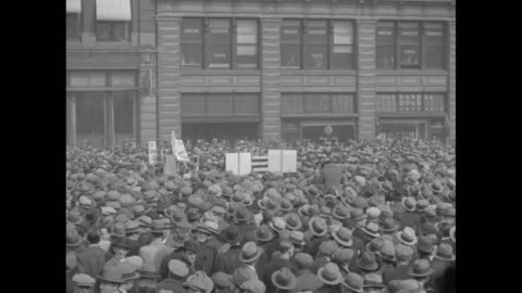 immense crowd in new york city, with cable cars moving in background / tilt-down rear shot people with signs move through crowd / section of crowd... - great depression stock videos & royalty-free footage