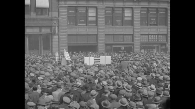 vs immense crowd in new york city with cable cars moving in background / tiltdown rear shot people with signs move through crowd / section of crowd... - 1930 stock-videos und b-roll-filmmaterial