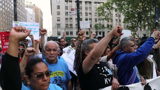 stockvideo's en b-roll-footage met immigrant rights advocates and others participate in rally and and demonstration at the federal building in lower manhattan against the trump... - immigrant