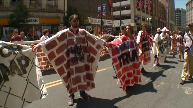 wjw immigrant rights protesters form human antitrump wall outside the 2016 rnc in cleveland ohio on july 20 2016 - surrounding wall stock videos & royalty-free footage