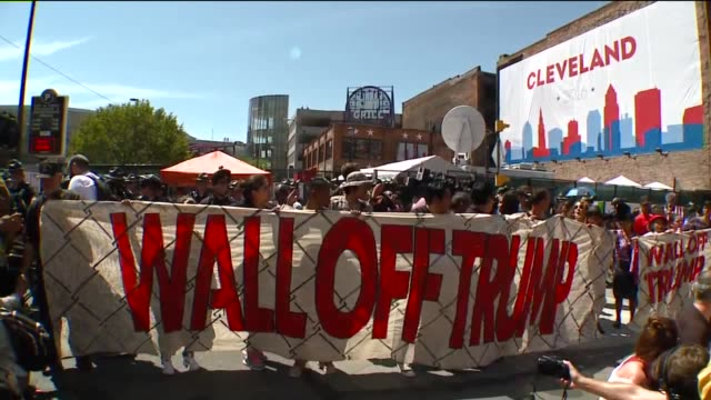 WJW Immigrant Rights Protesters Form Human AntiTrump wall Outside the 2016 RNC in Cleveland Ohio on July 20 2016