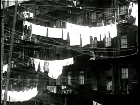 immigrant women hang laundry from their tenement building clotheslines - washing line stock videos & royalty-free footage