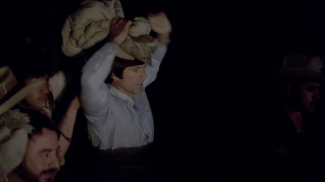 immigrants crossing the us border at night they get into the river and get wet while trying to cross the border dramatization - america latina stock videos & royalty-free footage