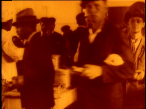 immigrants eat at long table in the cafeteria at ellis island. - 1910 stock videos & royalty-free footage