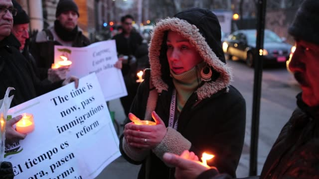 immigrants from colombia and ecuador representing members of new yorkers for real immigration reform gather to hold a candlelight vigil at washington... - darstellen stock-videos und b-roll-filmmaterial
