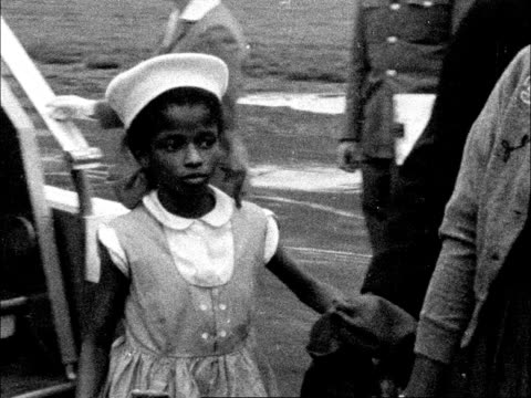 immigrants from jamaica arrive in england; england: lap london airport: ext people getting off plane; woman with child in arms comes towards: side... - 1950 stock videos & royalty-free footage