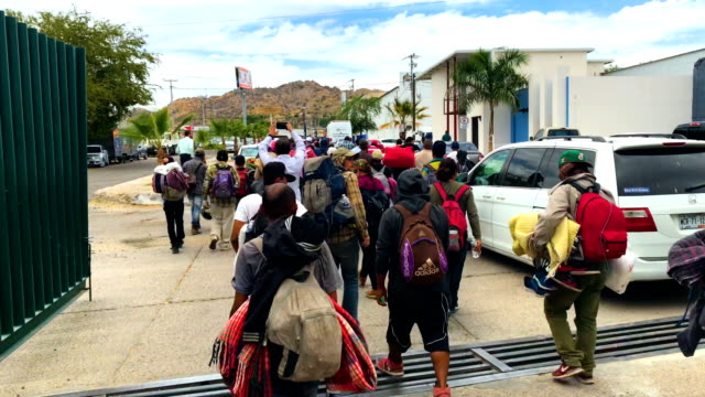 immigrants most of them from central america arrive by freight train for a rest stop on their journey to the usmexico border on april 21 2018 in... - america centrale video stock e b–roll