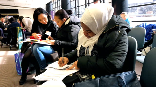 vídeos de stock e filmes b-roll de immigrants receive assistance with their u.s. citizenship applications at a citizenship now! event on february 3, 2018 in new york city. the event,... - cidadão
