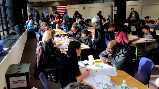 immigrants receive assistance with their us citizenship applications at a citizenship now event on february 3 2018 in new york city the event held by... - 市民点の映像素材/bロール