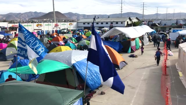 Immigrants spend the afternoon inside the Barretal migrant camp on December 4 2018 from Tijuana Mexico After traveling more than 6 weeks from Central...