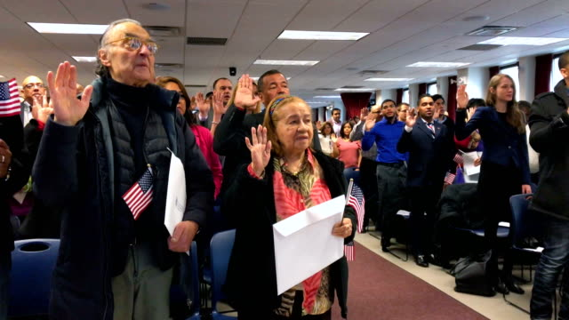 Immigrants take part in a naturalization ceremony on February 2 2018 in New York City US Citizenship and Immigration Services swore in 128 immigrants...