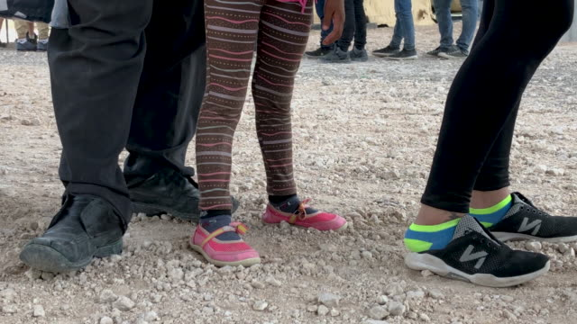 immigrants wait to be transported to a processing center after they were taken into custody by u.s. border patrol agents on july 02, 2019 in mcallen,... - mcallen texas stock videos & royalty-free footage