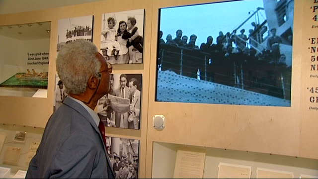 60th anniversary of empire windrush arriving at tilbury docks england south london imperial war museum int setup shots of sam king looking at archive... - hmt empire windrush stock videos & royalty-free footage
