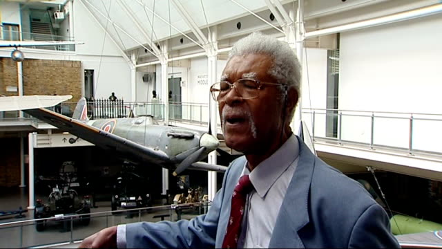 60th anniversary of empire windrush arriving at tilbury docks imperial war museum int reporter and sam king looking at windrush exhibition sam king... - hmt empire windrush stock videos & royalty-free footage