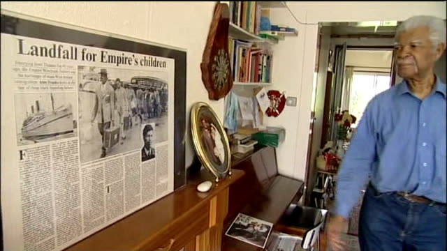 60th anniversary of empire windrush arriving at tilbury docks location unknown int set up shot of sam king at home showing framed newspaper article... - hmt empire windrush stock videos & royalty-free footage