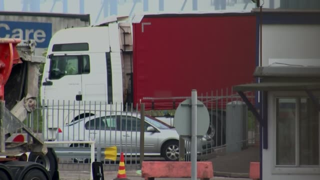suspected illegal immigrants found in harwich port containers; immigration border police and police vehicles in port area ambulance along through... - container stock videos & royalty-free footage