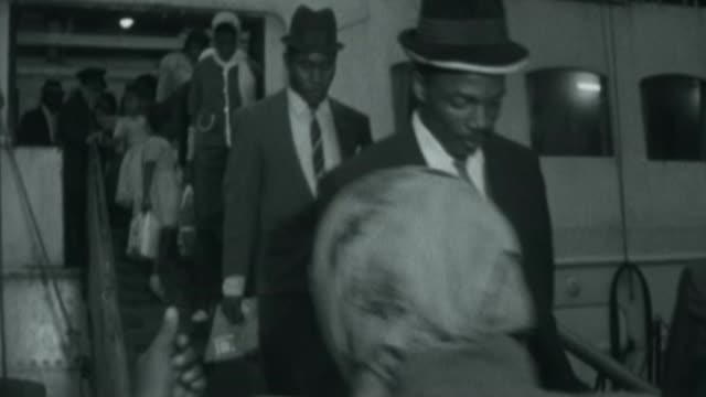 70th anniversary of the arrival of the Windrush generation X10026503 / 1021965 ENGLAND London EXT West Indian immigrants disembarking from ship...