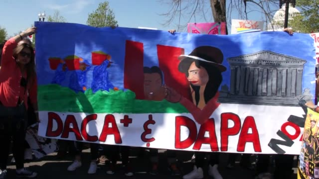Immigration activists demonstrate in front of the United States Supreme Court flanked by Supreme Court Police and Capitol Police officers Sequence...