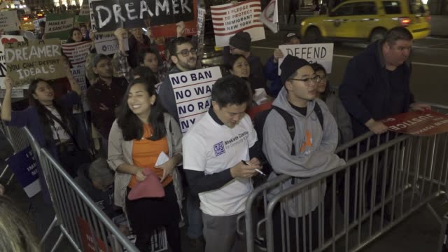 immigration advocates and supporters rallied at the 5th avenue trump tower demanding that congress pass the clean dream act and further legislation... - sanctuary city stock videos & royalty-free footage