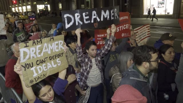 immigration advocates and supporters rallied at the 5th avenue trump tower demanding that congress pass the clean dream act and further legislation... - politisk sammankomst bildbanksvideor och videomaterial från bakom kulisserna