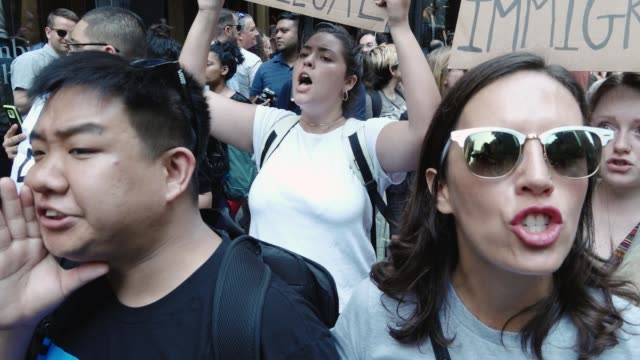 immigration advocates and supporters rallied in front the 5th avenue trump tower in midtown manhattan to protest attorney general jeff sessions'... - sanctuary city stock videos & royalty-free footage