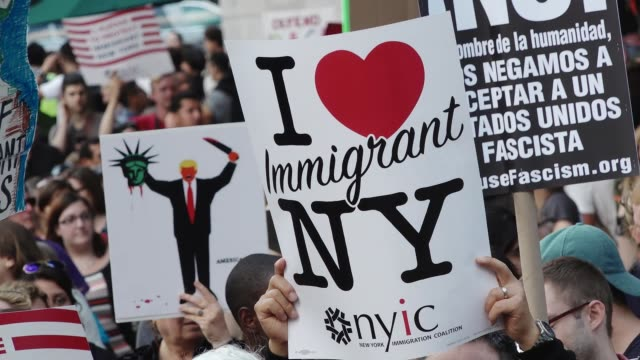 immigration advocates and supporters rallied in midtown manhattan's columbus circle near the trump tower international hotel in support of daca... - racism stock videos & royalty-free footage