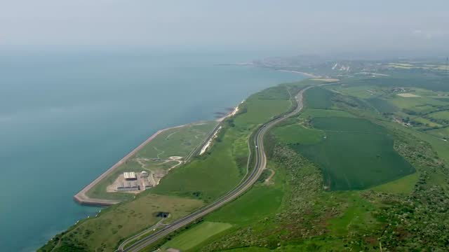 aerials of kent coastline; england: kent: ext air view / aerial port of dover with ferries, lorry park and vehicles along / track along coastline... - cliff stock videos & royalty-free footage