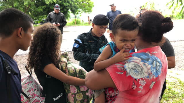 s immigration agents supervise as a guatemalan border policeman speaks with an immigrant mother and child before deporting them back to honduras on... - ice us homeland security stock videos & royalty-free footage