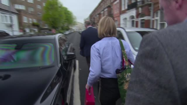 amber rudd facing growing calls to resign over deportation targets england london ext amber rudd mp along and getting in car as reporter heard asking... - deportation stock videos & royalty-free footage