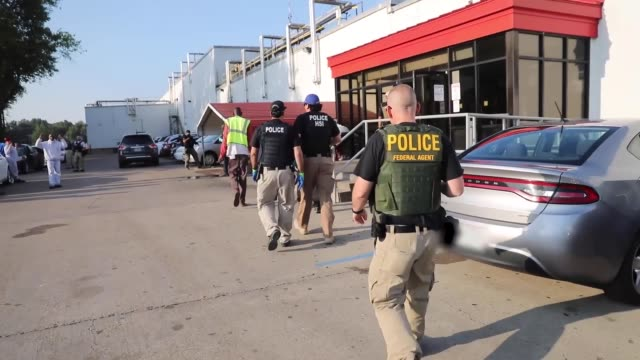 immigration and customs enforcement conducted a worksite enforcement operation in canton, mississippi. - 税関点の映像素材/bロール