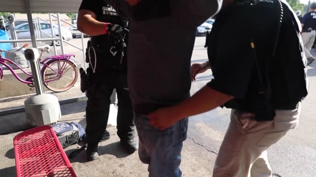 immigration and customs enforcement conducted a worksite enforcement operation in canton, mississippi. - handcuffs stock videos & royalty-free footage