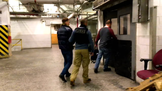 us immigration and customs enforcement officers process arrested undocumented immigrants at their office on april 11 2018 at the us federal building... - deportation stock videos & royalty-free footage