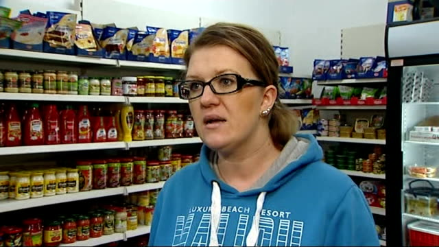 calls for tighter rules on benefits / conservative mps call for uk veto over eu laws; various of woman stacking shelf of polish sauce packets in shop... - vox populi stock videos & royalty-free footage