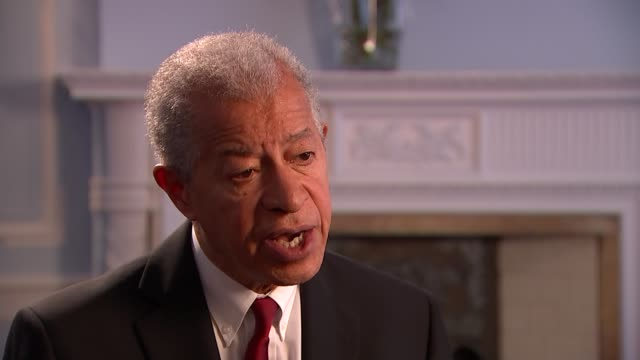 caribbean commissioners complain over threats to longterm uk residents london int lord ouseley interview with reporter sot - herman ouseley stock videos & royalty-free footage